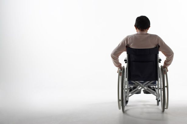 Senior-man-on-wheelchair-rear-view