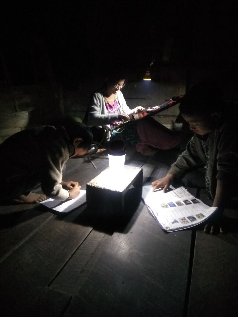 Solar lamps light the night for students in India.